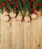 Christmas fir tree with decoration on a wooden board