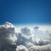 Blue sky and cloud background from above the clouds