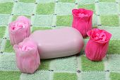 Colorful pieces of soap on towel background