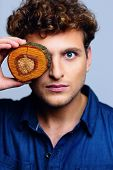 Portrait of a serious man closed his eye by wood circles