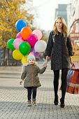 pic of children walking  - happy woman and little child with red shopping bag and air - JPG