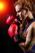Beautiful Girl With Red Boxing Gloves, Dreadlocks On A Black Background.