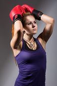 Portrait Of Beautiful Girl With Red Boxing Gloves, Looking Up