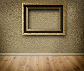 Wooden Vintage Frame On A Wall.