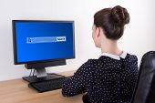 Young Beautiful Business Woman Using Pc With Search Bar On Screen