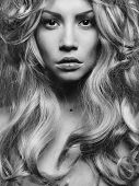 stock photo of perm  - Black and white portrait of beautiful woman with magnificent blond hair - JPG