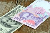 Dollars Euro Hryvnia Banknotes On Wooden Background
