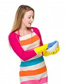 Housewife cleaning of kitchen utensil
