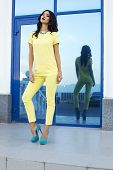 Beautiful Fashion Model Wearing Elegant Yellow Suit And Blue Shoes