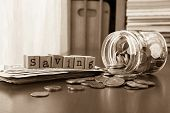 Money Saving Word With Coins And Banknotes, Sepia Toned