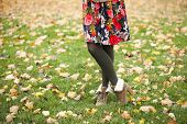Female wool tights and autumn shoes - body part
