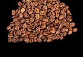 Coffee beans on the black background