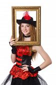 Woman pirate with picture frame isolated on white