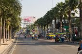January 14, 2012: The street of with active traffic in Thailand in the afternoon