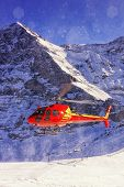 Red Helicopter Landing At Swiss Ski Resort Near Jungfrau Mountain