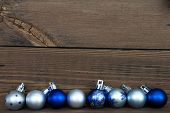 Christmas Balls In A Row On Wood With Copy Space