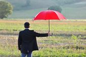 Insurance And Protection Concept, Businessman With Umbrella In The Field