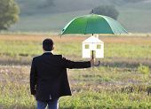 Home Insurance Protection Concept, Businessman With Umbrella