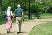 Elderly Couple Walking Hand in Hand
