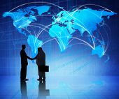Multi-Ethnic Businessmen Shaking Hands with a Global Communication Background
