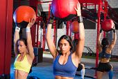 Gym women weighted ball rising workout exercise together