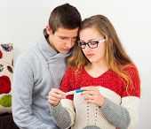picture of teen pregnancy  - Sorrowful young couple facing real problem pregnancy - JPG