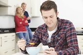 image of mature adult  - Mature Parents Frustrated With Adult Son Living At Home - JPG