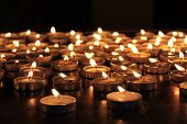 stock photo of darkness  - burning memorial candles on dark background  - JPG