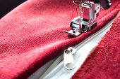 picture of zipper  - sewing a white zipper on a sewing machine - JPG