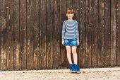 picture of denim wear  - Outdoor portrait of a cute little girl - JPG