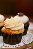 image of sugarpaste  - Gourmet cupcakes baked and frosted with icing vanilla - JPG
