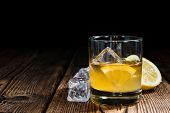foto of whiskey  - Whiskey Sour with ice cubes  - JPG