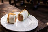 pic of ooze  - Sausage Cheese Rolls on white dish wood table - JPG