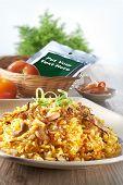 stock photo of nasi  - Nasi Briyani with ingredient on nice table setting - JPG