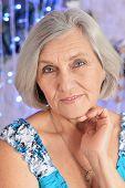 stock photo of beautiful senior woman  - Beautiful senior woman portrait on illuminated background - JPG