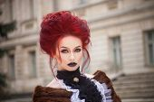 image of gothic female  - sexy woman with gothic makeup and red hair and castle - JPG