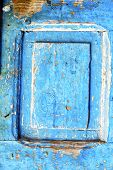picture of nail paint  - nail stripped paint in the blue wood door and rusty - JPG