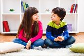 stock photo of little boys only  - Little boy and little girl are sitting in living room and thinking what to play - JPG