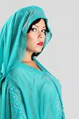 picture of yashmak  - Adult Beautiful arabian woman in blue abaya - JPG