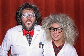 stock photo of mad scientist  - A young couple dressed as mad professors