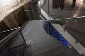 image of spiral staircase  - Upside view of a spiral staircase angle shot - JPG