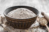 pic of buckwheat  - Buckwheat flour in a bowl on a wooden table - JPG
