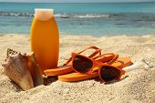 pic of sun tan lotion  - Sun tan lotion on a sandy beach - JPG