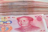 stock photo of yuan  - A stack of 100 renminbi or yuan Chinese money - JPG