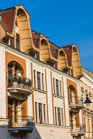 stock photo of tenement  - Facade of an Art Noveau tenement with remarkable attic in Tarnowskie Gory - JPG