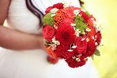 foto of wedding feast  - Capture of Bride holding red wedding bouquet - JPG
