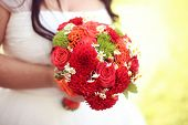 image of wedding feast  - Capture of Bride holding red wedding bouquet - JPG