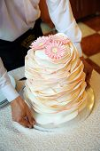 stock photo of ombre  - Wedding cake with chrysanthemums on top of it