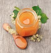 picture of linden-tree  - Linden honey with linden flowers on wooden texture - JPG