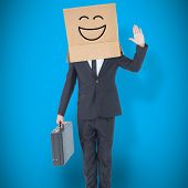 picture of anonymous  - Anonymous businessman against blue background with vignette - JPG